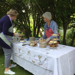 Beaufort House Akaroa 2020 House & Garden Tour Lady serving cake