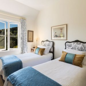 Bedroom with 2 single beds at Beaufort House luxury accommodation in Akaroa